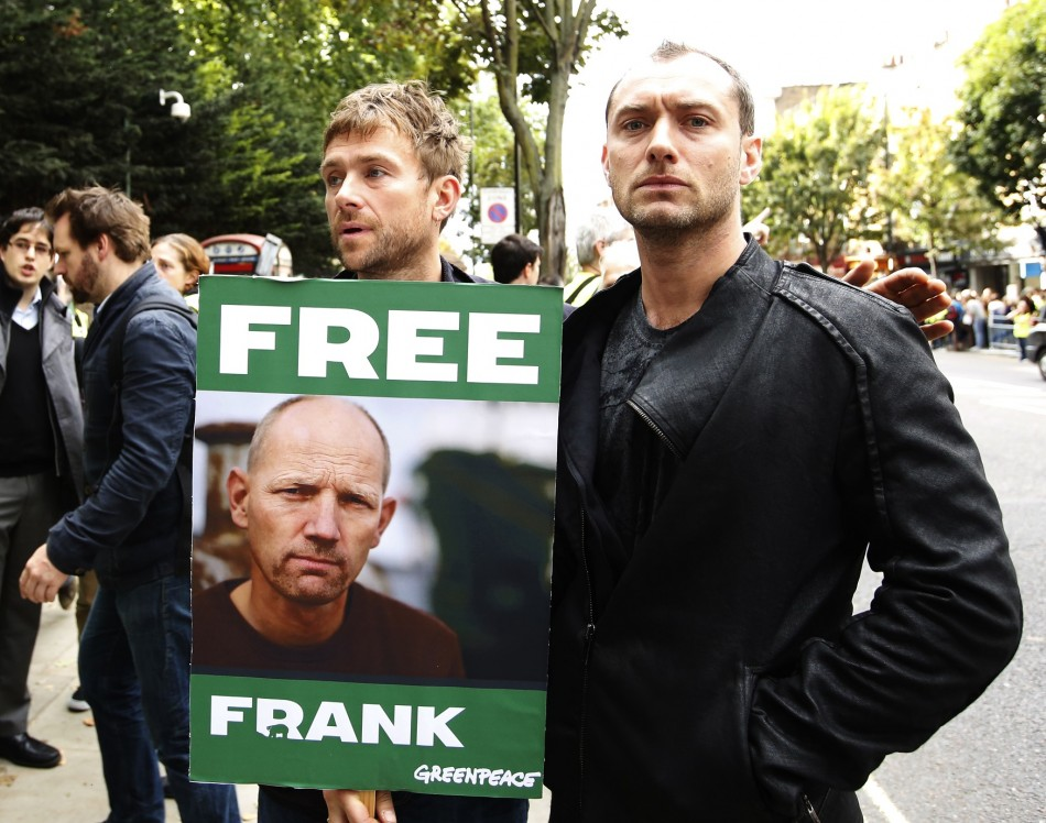 Damon Albarn (L) and Jude Law join protesters outside the Russian embassy in London.