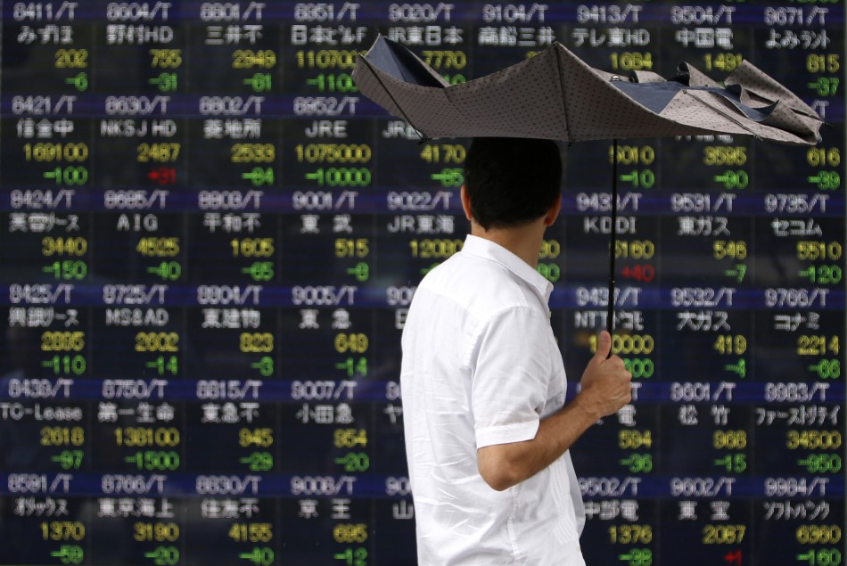 Asian markets reverse early gains and trade lower on 7 October