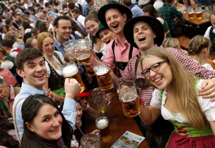 Visitors from London cheer with mugs of beer during the last day of the 180th Oktoberfest in Munich. (Photo: Reuters)