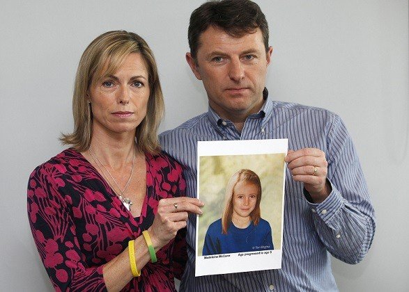 Kate and Gerry McCann pose with a computer generated image of how their missing daughter Madeleine might look now (Reuters)
