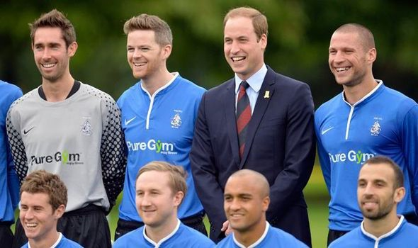 Prince William with footballers of Polytechnic FC PIC: Reuters