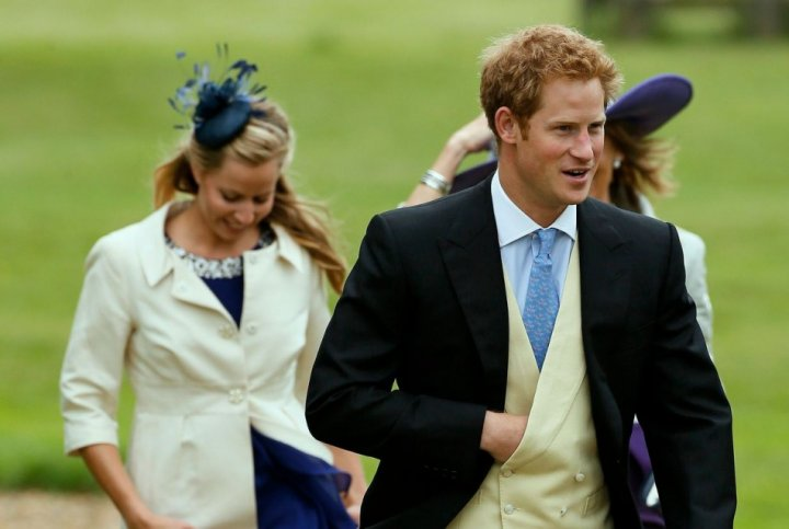 Prince Harry arrives for the wedding of Prince William's friends at St Nicholas Church in Gayton, eastern England on 14 September. Prince Harry may soon marry his girlfriend, claims a new report. (Photo: Reuters)