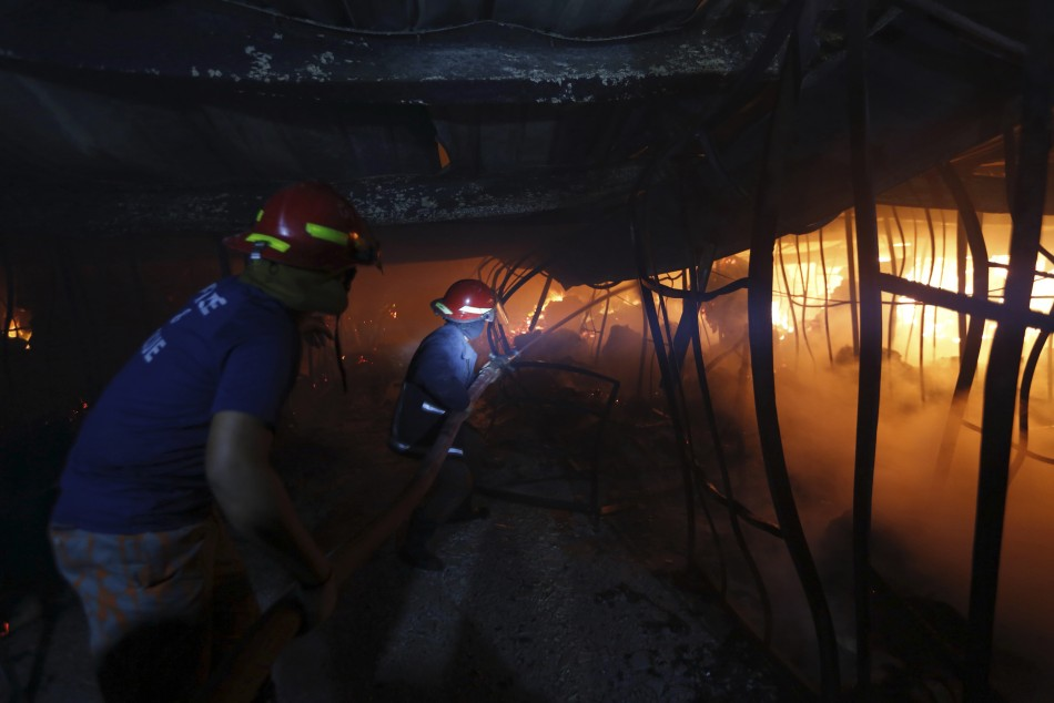 Firefighters try to control a fire inside a garment factory in the Bangladeshi town of Gazipur