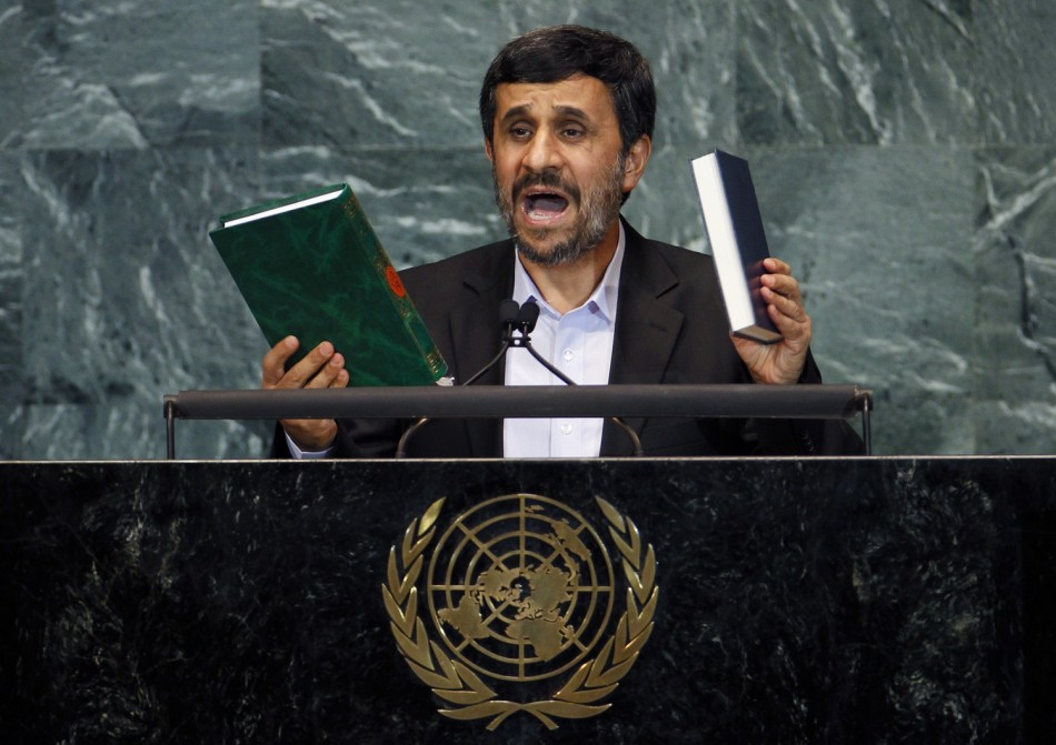 Iran's President Mahmoud Ahmadinejad holds up copies of the Koran (L) and the Bible as he addresses the 65th United Nations General Assembly at the U.N. headquarters in New York, September 23, 2010