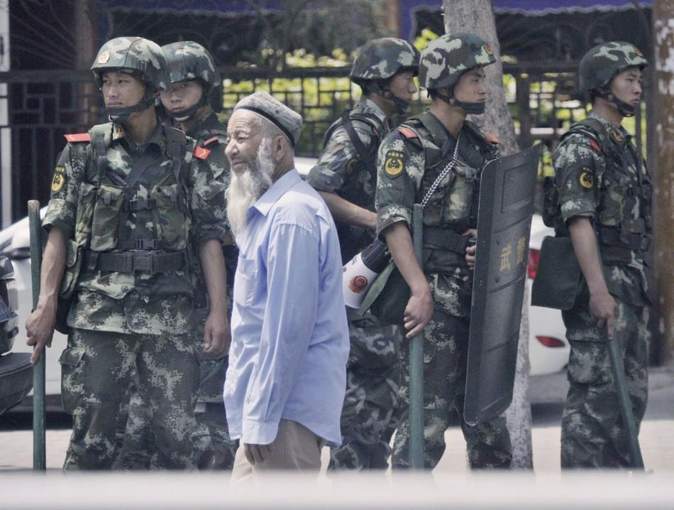 Xinjiang police arrest Muslim