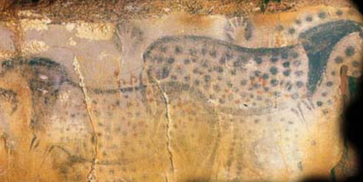 Four of the six black hand stencils associated with the Spotted Horse mural in the prehistoric Pech Merle cave in France were made my females, according to a study. (Photo: Dean Snow/Pennsylvania State University)