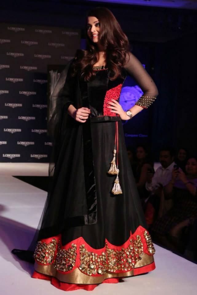 Aishwarya Rai Bachchan looked ravishing in a red and black lehenga (Facebook/AshOfficial)