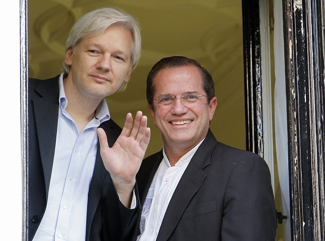 Julian Assange (L) at the Ecuador Embassy with a South American official PIC: Reuters