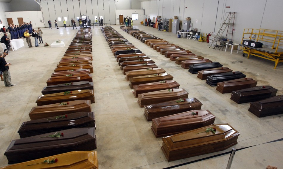 Coffins of victims from a shipwreck off Sicily are seen in a hangar of the Lampedusa airport
