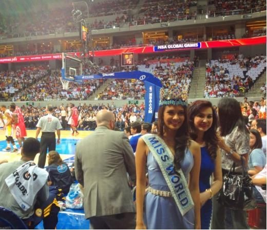 Megan Young takes courtside seats at NBA game in Manila on 10 October. (Photo: Miss World organisation)