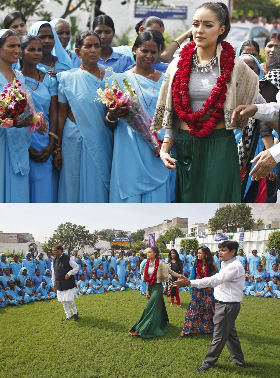 Miss Universe 2012 Culpo, wearing floral garlands, arrives to meet women at a school in New Delhi. (Photo: Miss Universe Organization)