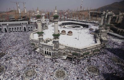 Muslim pilgrims attend Friday prayers at the Grand mosque in the holy city of Mecca ahead of the annual Hajj pilgrimage
