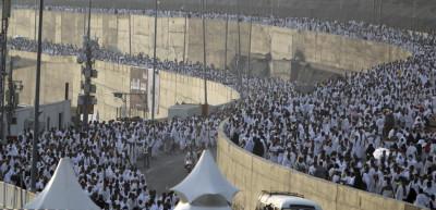 Muslim pilgrims arrive to cast stones at pillars symbolising Satan, as part of a Hajj pilgrimage rite