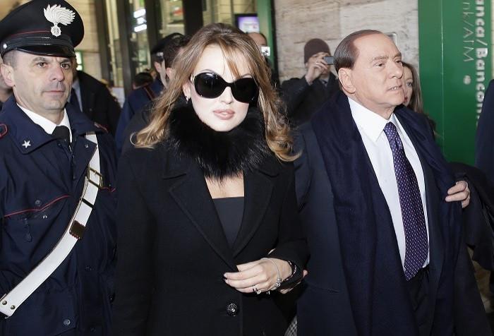 Former Italian Prime Minister Silvio Berlusconi (R) and his fiancée Francesca Pascale.