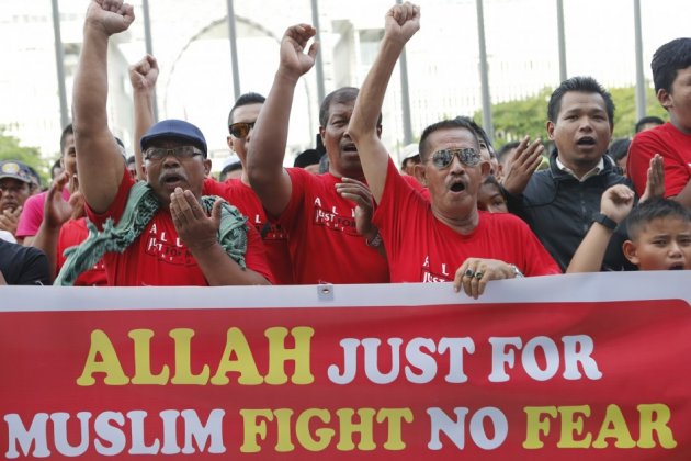 Muslim demonstrators chant slogans outside Malaysia's Court of Appeal in Putrajaya, outside Kuala Lumpur
