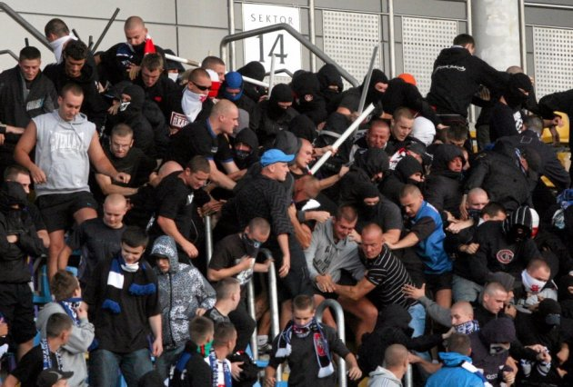 Football fans in Poland clash with police at a match Widzew Lódz and Zawisza Bydgoszcz PIC: Reuters