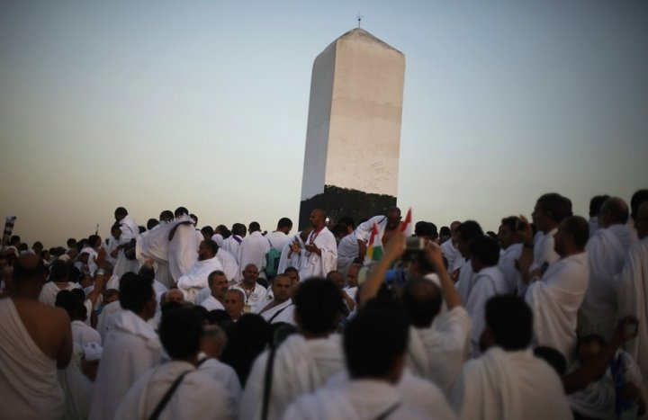 Muslim pilgrims gather atop Mount Mercy on the plains of Arafat