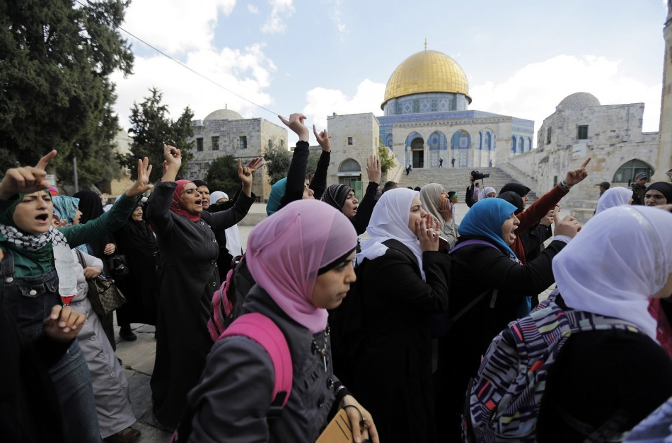 Palestinian women protest following minor clashes at the compound known to Muslims as Noble Sanctuary and to Jews as Temple Mount in Jerusalem's Old City
