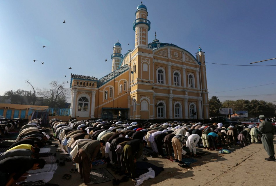 Afghan men attend Eid al-Adha prayers in Kabul. (Photo: Reuters)