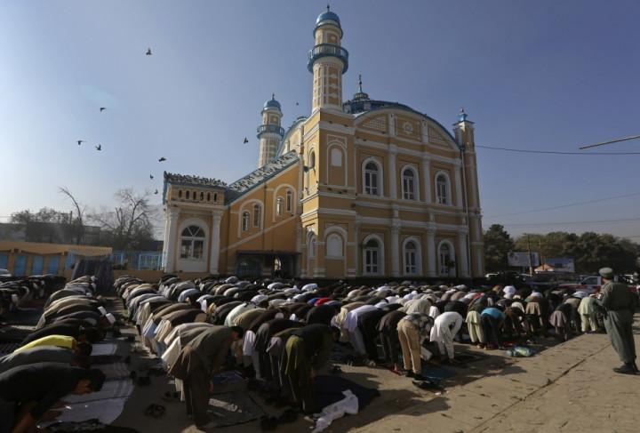 Afghan men attend Eid al-Adha prayers in Kabul