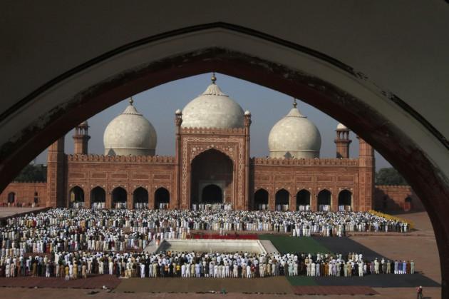 Pakistani Muslims attend a mass prayer for Eid al-Adha