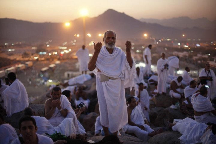 A Muslim pilgrim prays atop Mount Mercy on the plains of Arafat during the peak of the annual haj pilgrimage, near the holy city of Mecca. (Photo: REUTERS)