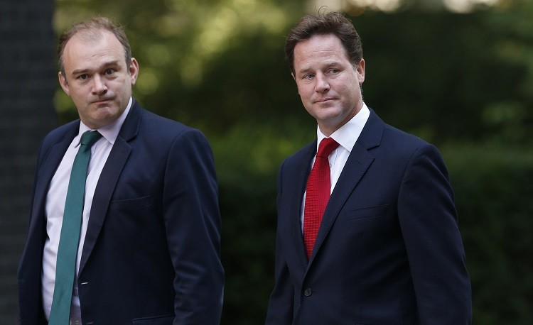 Energy and Climate Secretary Ed Davey (L) and Deputy Prime Minister Nick Clegg at 10 Downing Street in London . Britain's government is under pressure to battle with Labour over energy price hikes (Photo: Reuters)