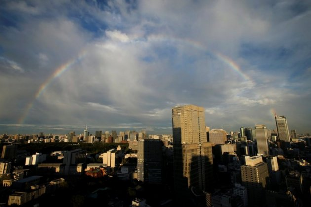 A rainbow is seen over high rise buildings in Tokyo