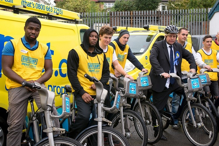 The applicants pose with a Boris Johnson impersonator as during the bootcamp