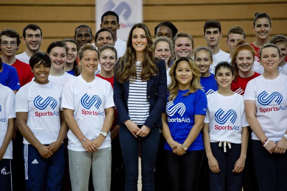 Kate Middleton poses for a group photograph with young athletes. (Photo: REUTERS)