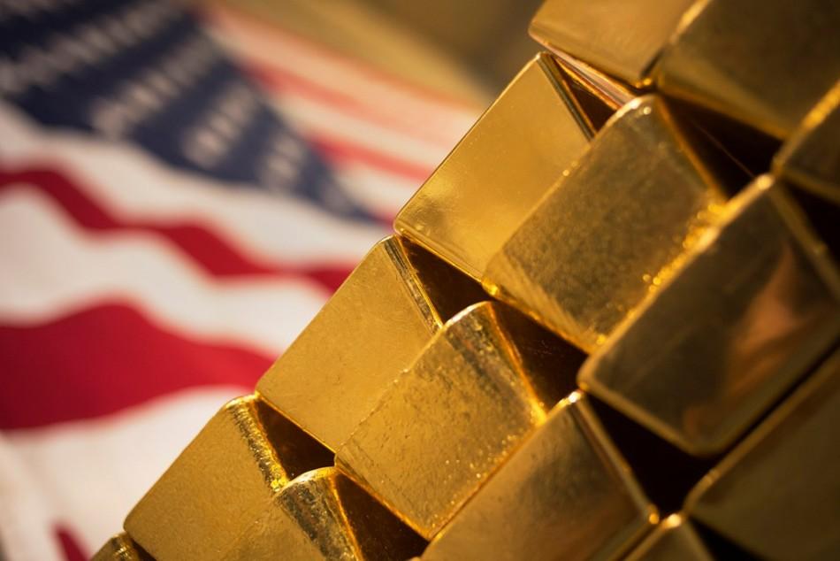 Gold Near 2-week Lows on Stronger Dollar, U.S. data