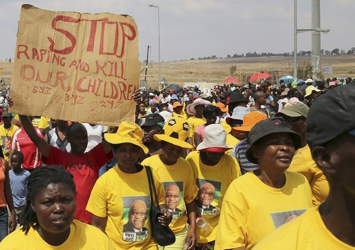 Crowd of protesters outside a local police station in Diepsloot