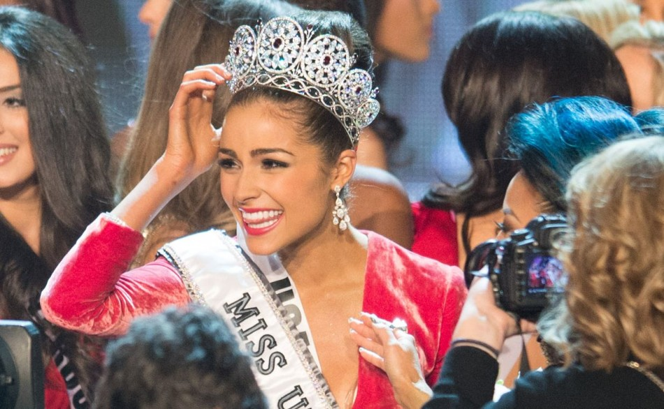 Miss Universe 2012, Olivia Culpo, poses with the Diamond Nexus Labs crown as she celebrates onstage at the close of the 2012 Miss Universe Competition in Las Vegas, Nevada on December 19, 2012. Culpo will give the crown to the winner of this year's pagean