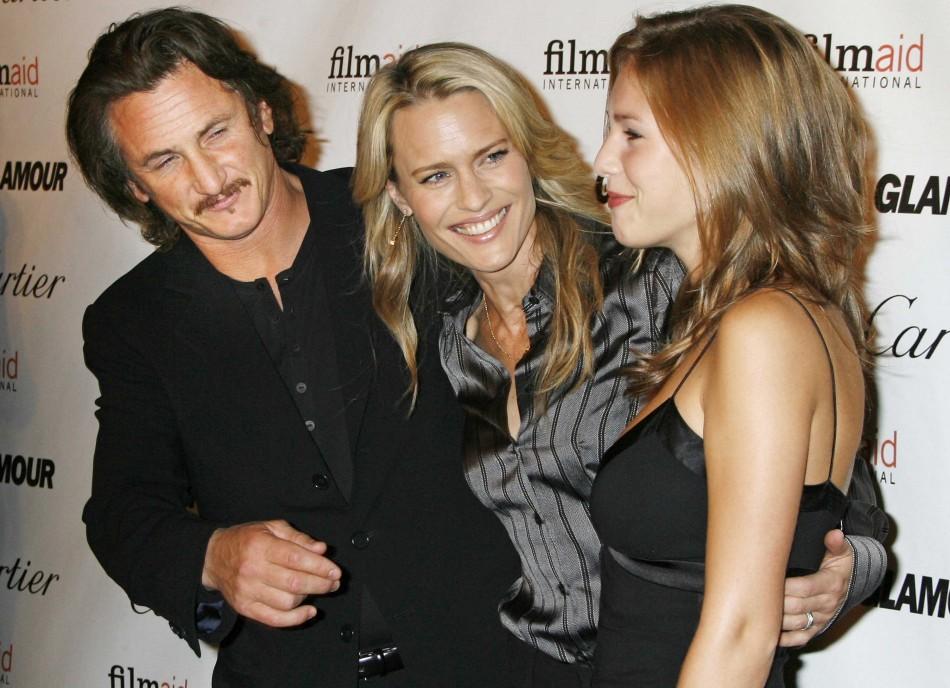 Actor Sean Penn (L), his wife Robin Wright Penn (C) and their daughter Dylan Frances Penn.
