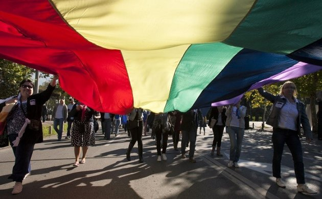 Gay-rights supporters carry a rainbow flag as they walk during a Pride March in Montenegro.