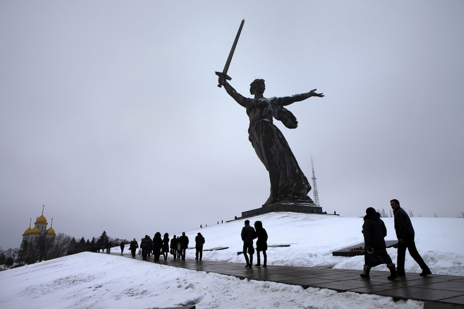 People walk at the Mamayev Kurgan (Mamayev Hill) World War Two memorial complex, with the statue of Mother Homeland in the background during celebrations in the city of Volgograd