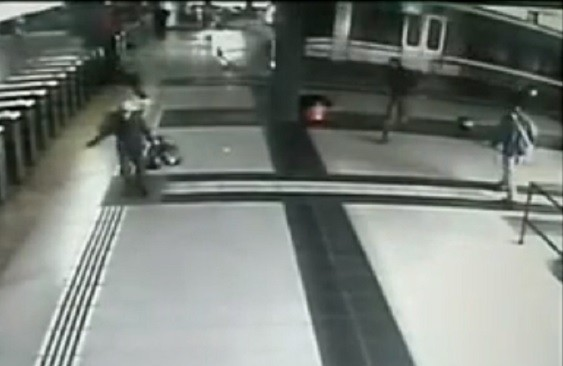 Bystanders flee as train mounts platform at Once station in Buenos Aries PIC: Youtube