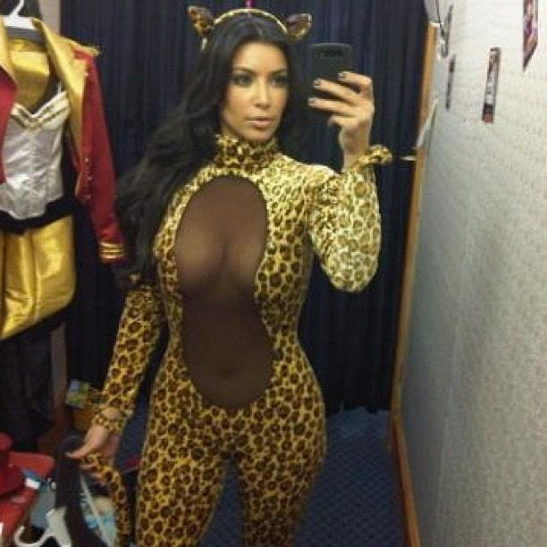 Kardashian in a leopard body suit Kitty costume [Kim Kardashian/Celebbuzz]