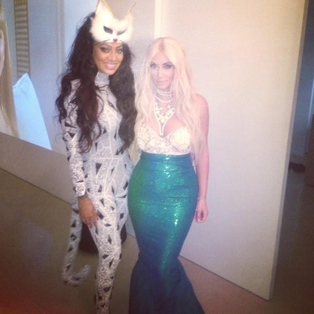 Dressed as a mermaid with blonde locks, pearls, a green fin and seashell bra [Kim Kardashian/Celebbuzz]