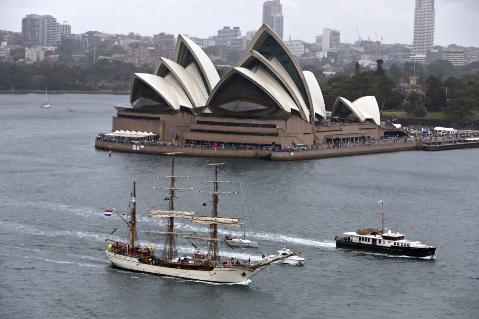 A tall ship sails past the Sydney Opera House as it enters Sydney Harbour as part of the International Fleet Review celebrations