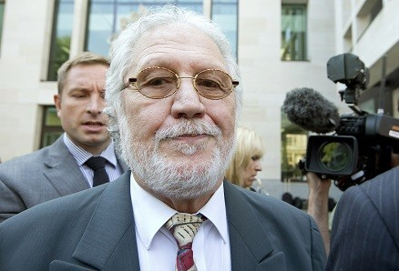 Dave Lee Travis is due to stand trial in March 2014 (Reuters)