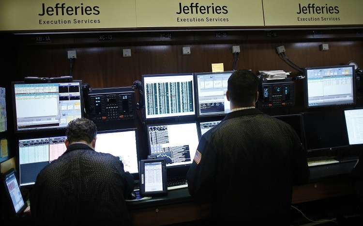 Trading specialists from Jefferies work on the floor of the New York Stock Exchange (Photo: Reuters)