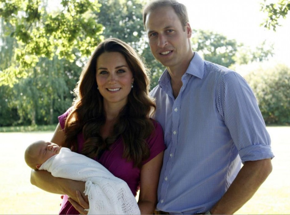 Kate Middleton, Prince William and Prince George in their first official family photo. George's first official portrait will be taken at his christening on 23 October. (Photo: Clarence House)