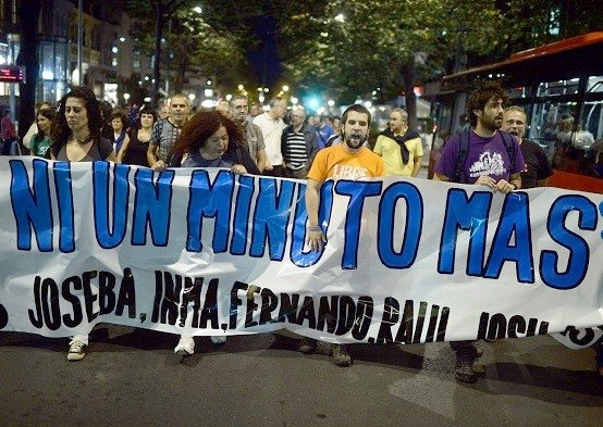 Supporters of ETA prisoners carry a protest banner during October 2013