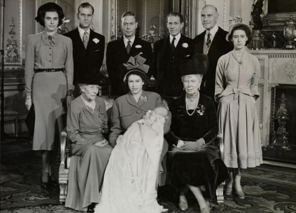 The Queen with infant Prince Charles during his Christening on 15th December 1948. (Photo: Clarence House)