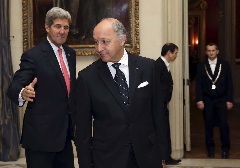 French Foreign Affairs Minister Laurent Fabius (C) welcomes U.S. Secretary of State John Kerry (L)