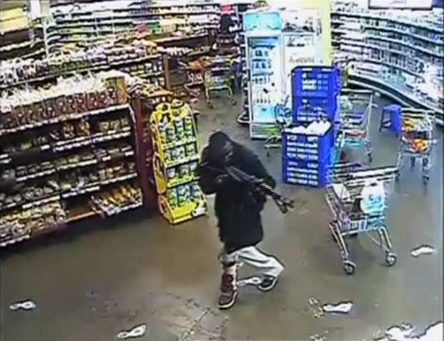 A gunman aims his rifle inside a store during an attack on the Westgate shopping mall