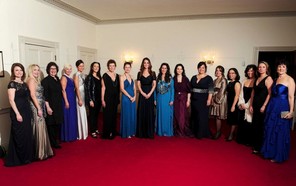 Duchess of Cambridge poses for a picture with members of the board of 100 Women in Hedge Funds at a gala dinner. (Photo: Reuters)