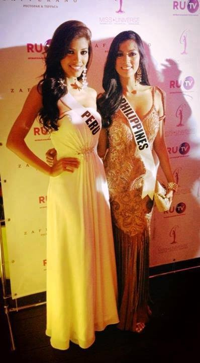 Misses Universe Peru and Philippines get along at dinner gala. (Photo: Facebook)