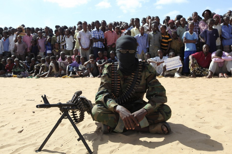 Al Shabaab fighter at a demonstration to annmounce the group merging with al-Quaida last year in Moghadishu, Somalia.